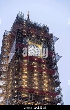 London, UK. 6th Nov, 2019. Elizabeth Tower, previously known as Clock Tower, housing Big Ben (the nickname for the Great Bell of the striking clock at the Palace of Westminster in London) is lit up while shrouded in scaffolding. Major refurbishment works will continue until 2021 when we will hear the regular bongs of the bell once more. Credit Lee Hudson - Stock Photo