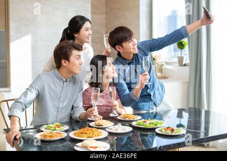 Young friends taking selfie at home - Stock Photo