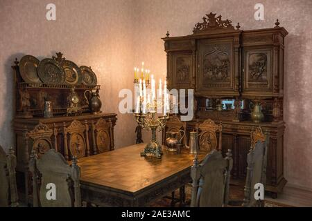 Antique kitchen interior in traditional Belgian style and candelabra with candles. The late 19th century. - Stock Photo