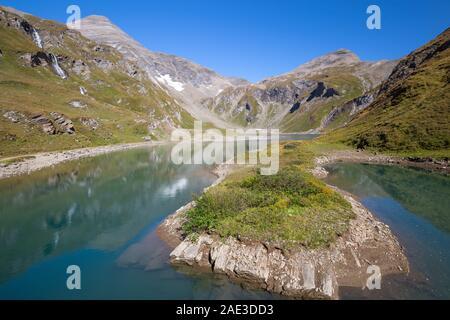 Nassfeld Speicher (Naßfeldspeicher) alpine lake near Grossglockner High Alpine road. Hohe Tauern National Park. Austrian Alps. - Stock Photo