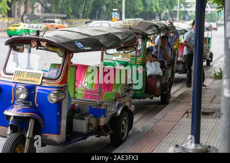 Tuk-tuk is one of the most popular and convenient ways to move around the city in Bangkok. - Stock Photo