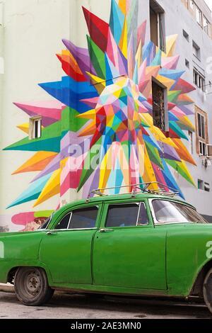 Green car in front of a street graffiti, Havana-Cuba