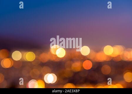 Soft defocused circullar night city lights. Abstract blur bokeh background.