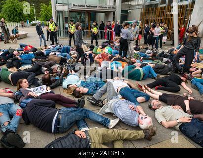 Extinction Rebellion climate change protest die-in at Scottish Parliament, Holyrood, Edinburgh, Scotland, UK - Stock Photo