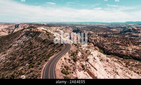 aerial view of country road winding through canyon landscape