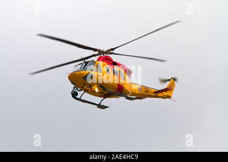 A Canadian Search and Rescue Helicopter approaches the Great Lakes International Airshow in St. Thomas, Ontario, Canada, on June 24 2011. - Stock Photo