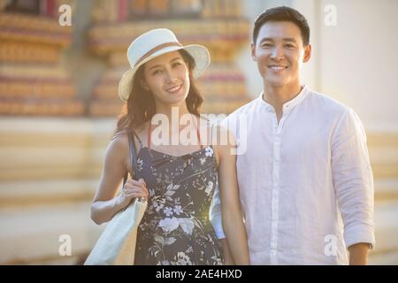Happy young couple on vacation in Thailand - Stock Photo