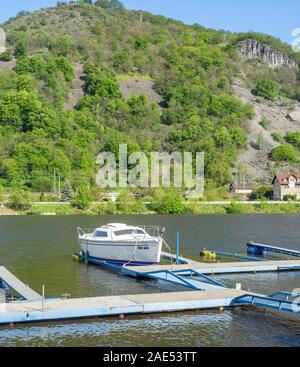 Boat moored to a pontoon at Církvice Dock on the Elbe River or Labe River between Litomerice and Ústí nad Labem Czech Republic. - Stock Photo