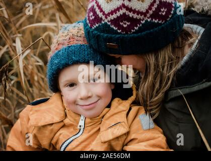 candid portrait of mother and son smiling whilst playing outside