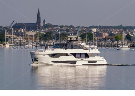 Fairhaven, Massachusetts, USA - July 26, 2019: Motoryacht Golden Eye leaving Fairhaven with New Bedford waterfront in background. Editorial use only. - Stock Photo