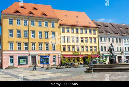 Marktplatz Market Square  lined with traditional buildings hotels and restaurants in Altstadt Torgau Saxony Germany. - Stock Photo