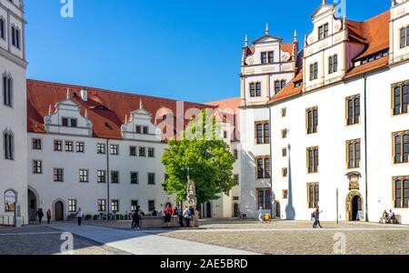 Cobblestone courtyard of Castle Hartenfels Altstadt Torgau Saxony Germany - Stock Photo