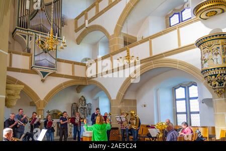 Brass band playing in Castle Hartenfels chapel the first Protestant church in the world, Altstadt Torgau Saxony Germany. - Stock Photo
