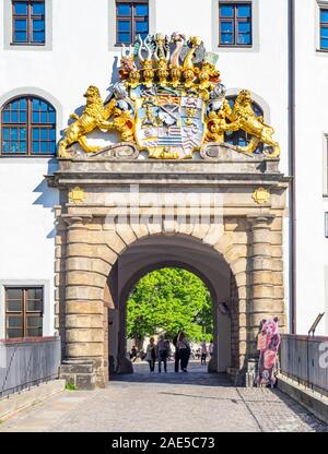 Coat of arms over archway entrance to Castle Hartenfels in Alstadt Torgau Saxony Germany. - Stock Photo