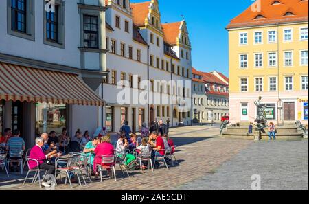 Marktplatz Market Square  lined with traditional buildings hotels and alfresco restaurants in Altstadt Torgau Saxony Germany. - Stock Photo