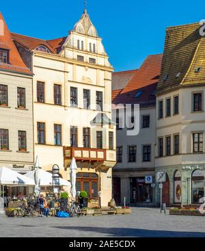 Marktplatz Market Square  lined with traditional buildings hotels and alfresco restaurants in Torgau Saxony Germany. - Stock Photo