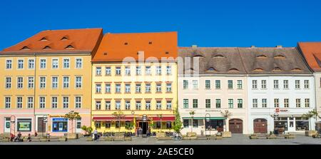 Marktplatz Market Square  lined with traditional buildings hotels and restaurants in Torgau Saxony Germany. - Stock Photo