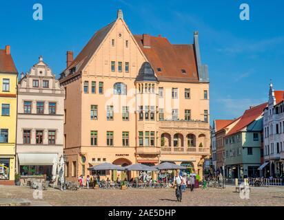 Renaissance building with oriel bay window and outdoor restaurants around Marktplatz  Lutherstadt WittenbergSaxony-Anhalt Germany.