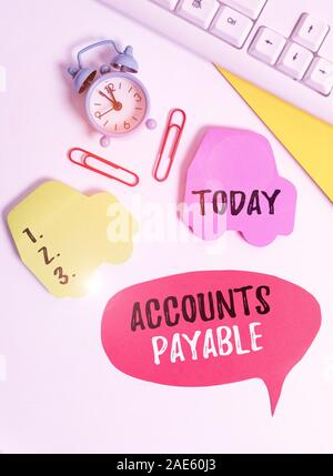 Writing note showing Accounts Payable. Business concept for money owed by a business to its suppliers as a liability Flat lay with copy space on bubbl