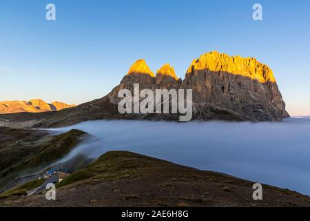 Cloud sea at Sella mountain pass between the provinces of Trentino and South Tyrol, Dolomites - Stock Photo