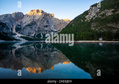 Beautiful reflection of Seekofel mountain in Lake Braies at sunrise, Italy - Stock Photo