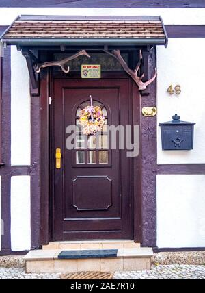 Small portic over obrown wooden door of a timber frame house in historic Altstadt Tangermünde Saxony-Anhalt Germany - Stock Photo