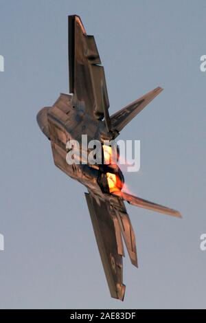 A US Air Force F-22 Raptor turns and burns during a demonstration at Airshow London, Ontario, Canada. - Stock Photo