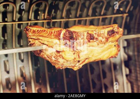 Pork ribs cut on electric grill, toned image - Stock Photo