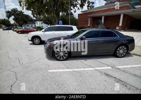 cars parked in back-in angle parking only on street kissimmee florida usa - Stock Photo