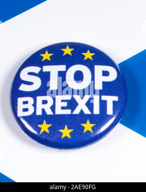 London, UK - December 3rd 2019: A Stop Brexit pin badge, pictured over the flag of Scotland. Stock Photo
