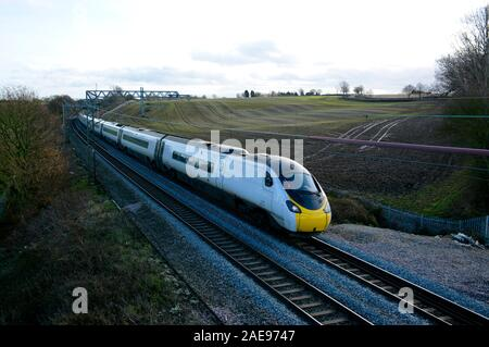 A Virgin Trains Class 390 Pendolino 390112 powers up the West Coast Main Line on the last day of the Virgin Trains Franchise, December 2019 - Stock Photo