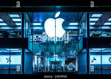HongKong - November,  2019: The Apple Logo on Apple Store facade in Hongkong at night - Stock Photo
