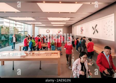 HongKong - November,  2019: Costumers nside the Apple Store in Hongkong at night - Stock Photo