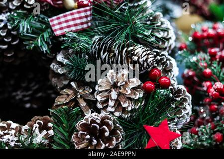 Background for Merry Christmas greetings card. Xmas wreath closeup with pine cones and artificial snow. Happy holidays. - Stock Photo
