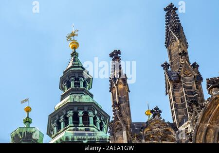 Peak of Great South Tower and sandstone spires on rooftop of Gothic St Vitus Cathedral Prague Castle Complex Prague Czech Republic.