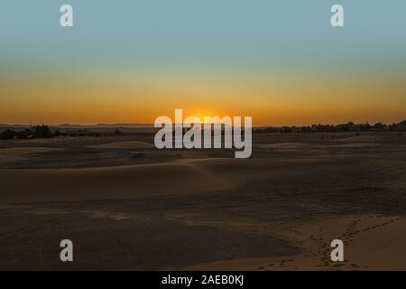 Sunset over the sand dunes of Erg Chebbi - Stock Photo