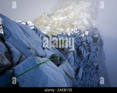 Snowy alpinism in Switzerland - Stock Photo