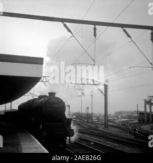 Steam trains running on British railways in 1967, towards the end of main line steam at Stockport, Lancashire, Northern England, UK - Stock Photo