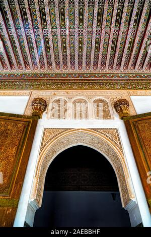 Detail of Richly carved, traditional pattern painted ceiling,door and wall of Bahia Palace. Combining traditional Moroccan and Islamic elements. - Stock Photo