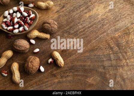 Set of different foods- whole grains, beans and legumes, seeds and nuts. - Stock Photo