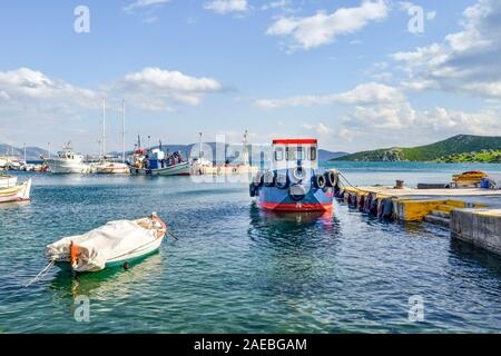 Fishing boats at small harbour in Pachi village. Megara,Greece - Stock Photo
