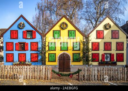 Traditional colorful half-timbered houses in Turckheim, Wine Route, decorated at Christmas, France Stock Photo