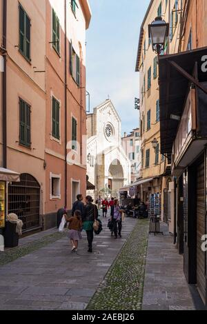 Pedestrian street in the old town of Sanremo, seaside city on the Italian Riviera - Stock Photo