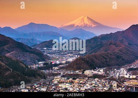 Otsuki, Japan Skyline with Mt. Fuji at twilight.