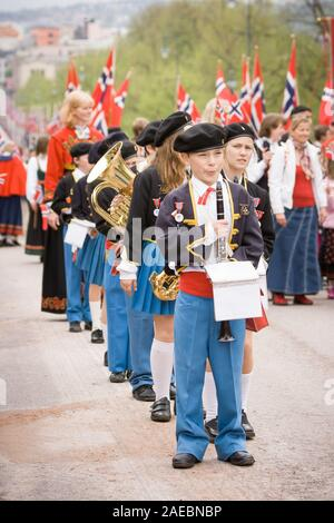 Oslo, Norway - May 17, 2010: National day in Norway. Norwegians at traditional celebration and parade on Karl Johans Gate street. - Stock Photo