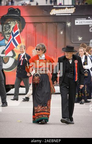 Oslo, Norway - May 17, 2010: National day in Norway. Senior Norwegians on traditional celebration and parade on Karl Johans Gate street. - Stock Photo