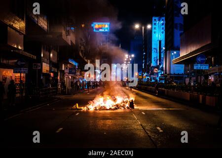 HongKong - November 17, 2019: Fire burning on Nathan Road as road barricade during the 2019 HongKong protests - Stock Photo