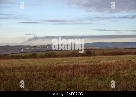 The large plume of smoke from the steel works at Port Talbot in South Wales seen from 10 miles away and drifting off across the countryside.
