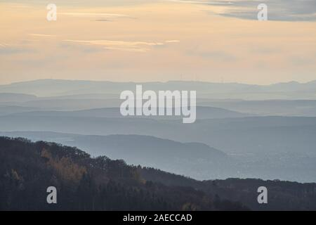 View over the hills at river Rhine in the light of an autumnal late afternoon sun. November Scene. - Stock Photo