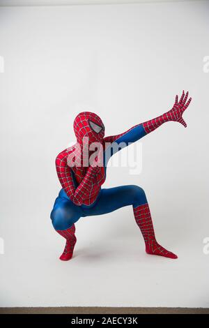 December 1, 2019. Israel, tel Aviv. Spiderman posing on a white background, the animator dressed as a spider in the pose concept of entertainment - Stock Photo